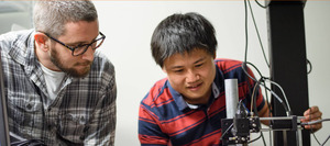Researchers with microscopes