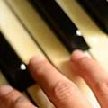 Fingers playing piano